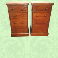Pair of Victorian mahogany bedside chests with turned handles