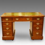 Edwardian walnut pedestal desk