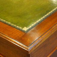 Edwardian walnut small pedestal desk gilt tooling