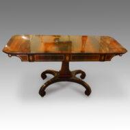 Regency brass inlaid sofa table on scroll feet