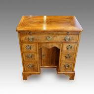 Edwardian walnut knee-hole desk