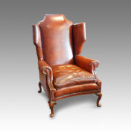 Queen Anne style walnut and leather wing chair