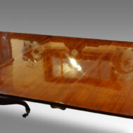Regency twin pillar mahogany dining table polished surface