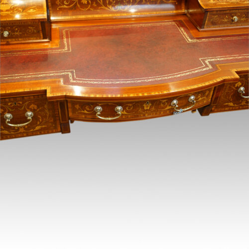 Edwardian inlaid mahogany writing desk bow front
