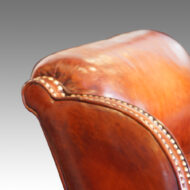 Pair of Edwardian leather club chairs detail