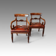 Pair of William IV mahogany scroll arm armchairs