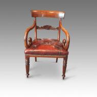 Pair of William IV mahogany scroll arm armchair