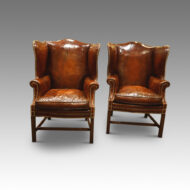 Antique pair of leather wing-chairs