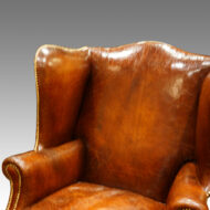 Antique wing-chair leather back