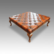 Large leather and walnut coffee table stool