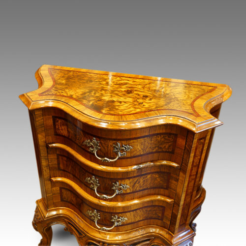 Pair of Antique serpentine bedside cabinets top