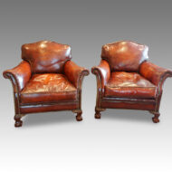 Pair of Edwardian club chairs with claw and ball feet