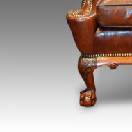 Frong leg of antique wing chair