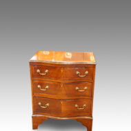 1920's small mahogany serpentine bedside chest