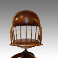 Edwardian oak revolving desk chair,1