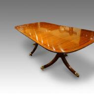 Regency style mahogany twin pillar dining table with ebony line inlay,4