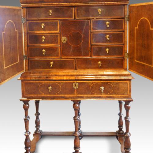 Antique walnut cabinet on stand
