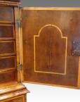 Walnut cabinet on stand interior of door