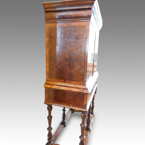 Antique cabinet on stand side