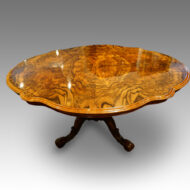 Shaoed Victorian walnut table