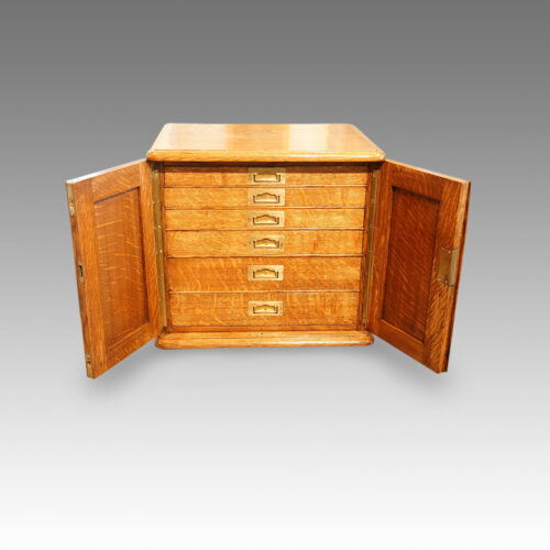 Edwardian oak collectors cabinet