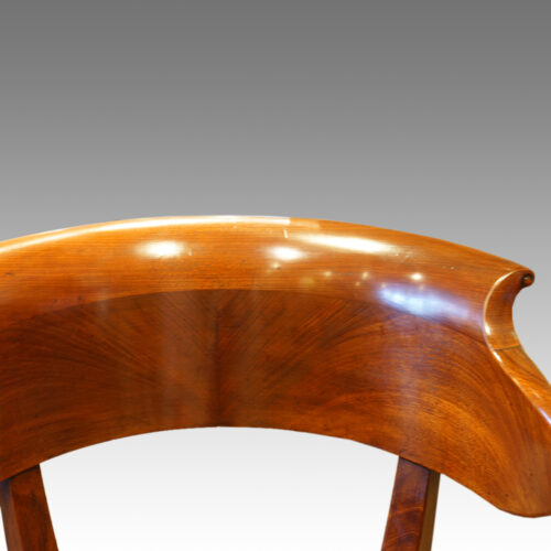Back rail of mahogany antique desk chair