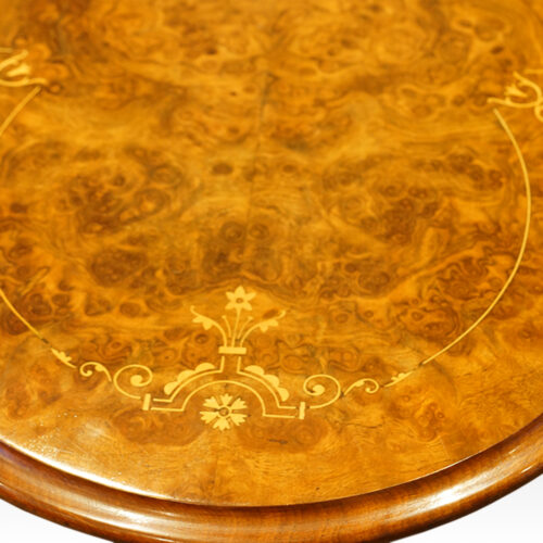 Inlaid burr walnut on Victorian table