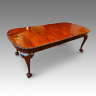 Edwardian mahogany claw and ball extending dining table