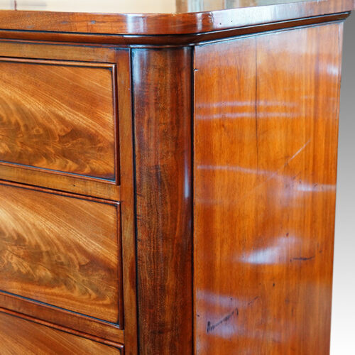 Large Victorian mahogany chest of drawers corner detail