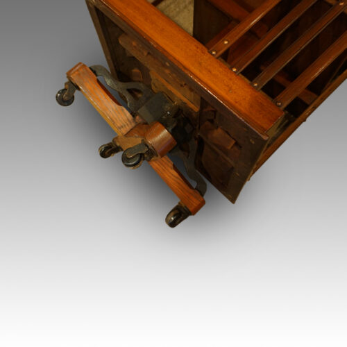 Victorian mahogany revolving bookcase showing the cast iron base