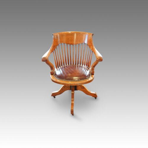 Edwardian oak spindle back revolving desk chair