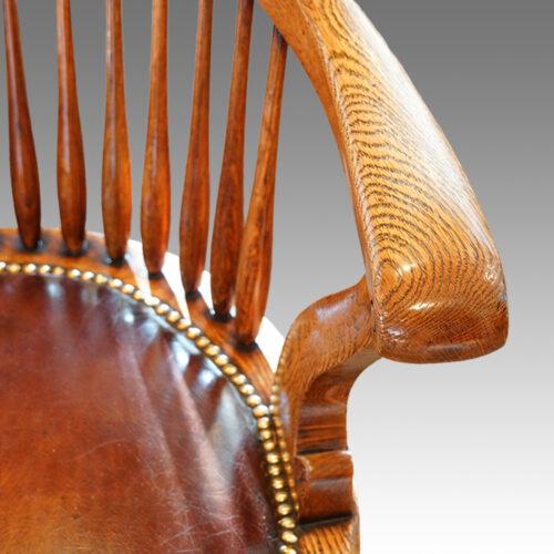 Edwardian oak spindle back revolving desk chair arm