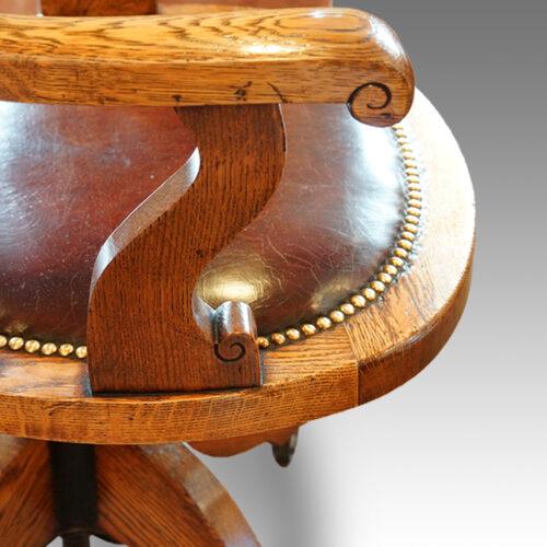 Edwardian oak spindle back revolving desk chair arm detail