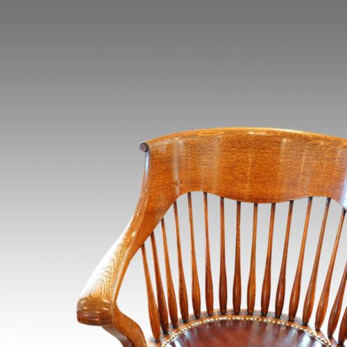 Edwardian oak spindle back revolving desk chair back detail