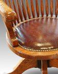 Edwardian oak spindle back revolving desk chair detail
