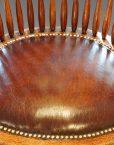 Edwardian oak spindle back revolving desk chair leather seat