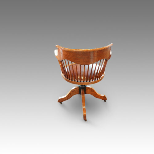 Edwardian oak spindle back revolving desk chair rear view