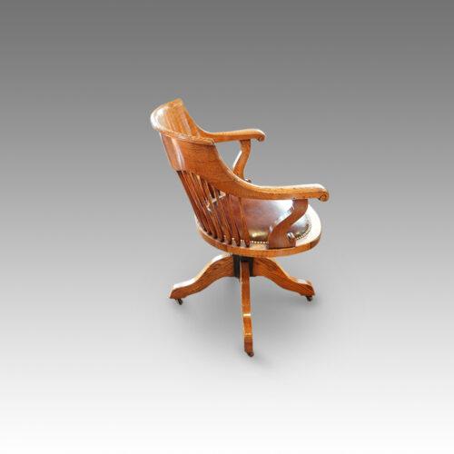 Edwardian oak spindle back revolving desk chair side view