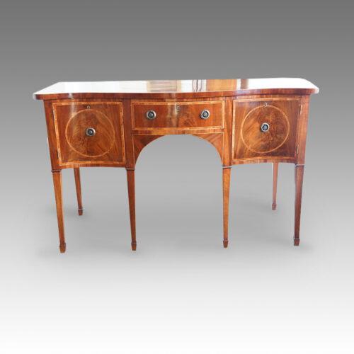Georgian serpentine mahogany inlaid sideboard