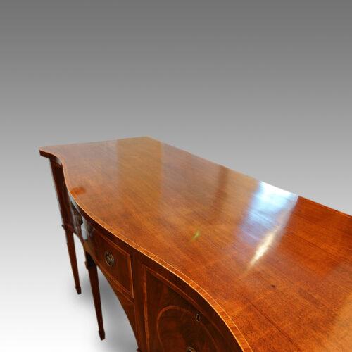 Georgian serpentine mahogany inlaid sideboard top view