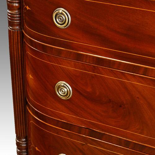 Regency inlaid mahogany D shape chest of drawers column