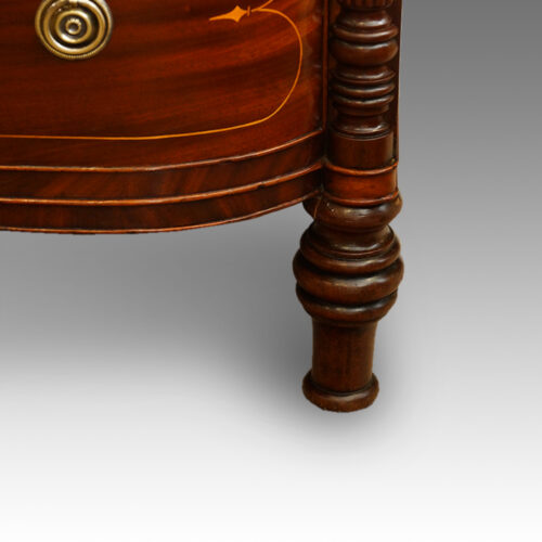 Regency inlaid mahogany D shape chest of drawers turned foot