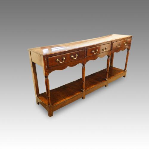 Antique oak narrow potboard dresser base at angle