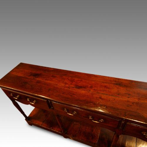 Antique oak narrow potboard dresser base at angle top boards