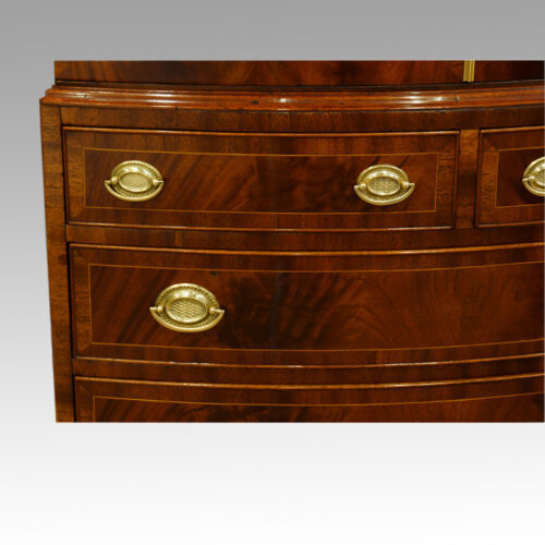 Mahogany bow front small linen press drawer detail