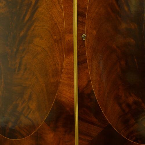 Mahogany bow front small linen press oval panels