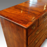 Queen Anne walnut and oak chest top detail