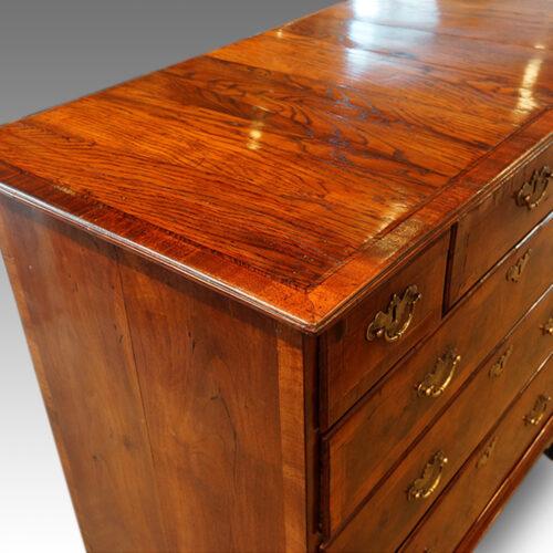 Queen Anne walnut and oak chest top detail
