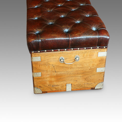 Victorian camphorwood and leather ottoman end view