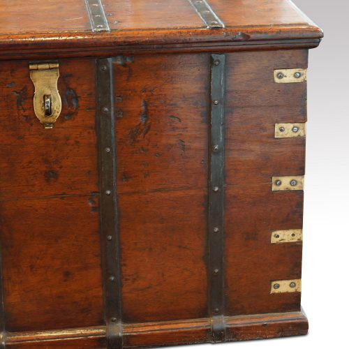Antique teak trunk with iron straps and brass corners detail